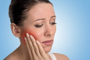 woman with tooth abscess pain